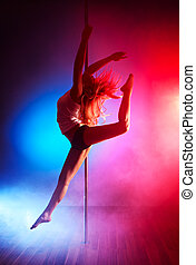 Young pole dance woman jumping
