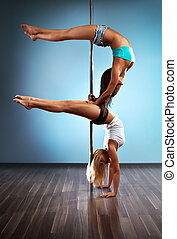 Two sexy women - Two young sexy pole dance women.