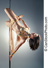 Young pole dance woman - Young sexy pole dance woman.