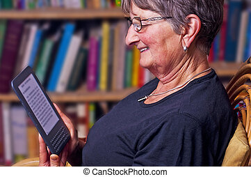 pensioner with e-book reader