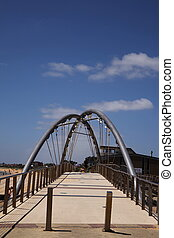 Board Walk Bridge at the beach with blue sky
