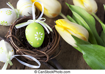easter eggs with yellow tulip flowers