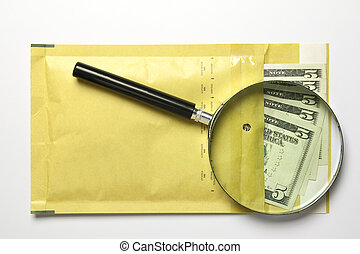 dollars in the envelope with magnifying glass isolated on...