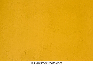 Yellow. - A background of yellow painted masonary with...