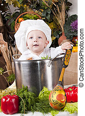 Portrait of a baby wearing a chef hat
