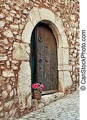Flowers on a doorstep, Collbato, Spain - Pot of red flowers...