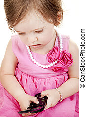 Baby Girl with Cell Phone - Cute baby girl in red and pink...