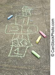 Hopscotch diagram and chalk - A diagram of the child's game...