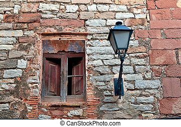 Old ruin wall with antique lantern, Collbato, Spain -...