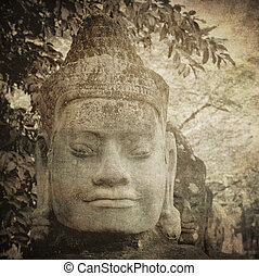 Head of gate guardian, Angkor, Cambodia - Vintage image of...