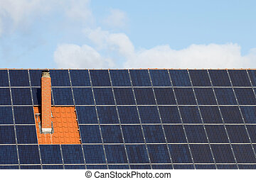 Solar cells around chimney - Many solar panels around a...