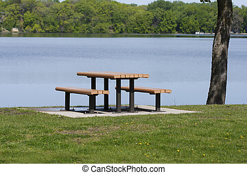 Picnic table by lake
