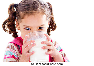 Child drinking milk - Stock image of female child drinking...