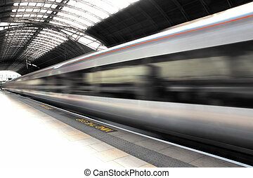 Train at Paddington Station - Train in blurred motion at...