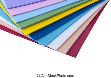 Colored sheets of plastic on a white background