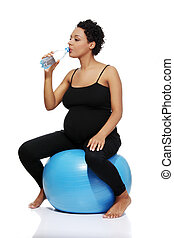 Pregnant woman during exercising. - Full lenght portrait of...