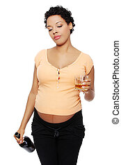 Pregnant woman in a bad habit - Front view of a pregnant...