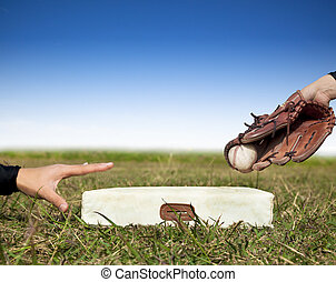 safe and force out concept.baseball player try to touch the...