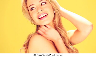 Stunning Blond Woman Smiling, close-up studio portrait on...