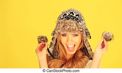 Vivacious Woman In Winter Hat - Vivacious laughing blonde...
