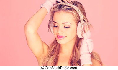 Happy Woman In Mitts And Earmuffs - Happy smiling blonde...