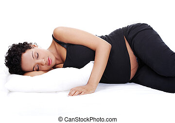 Pregnant woman while sleeping. - Portrait of a beautiful...