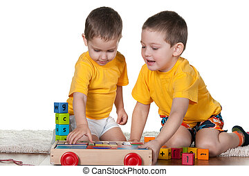 Two brothers playing blocks