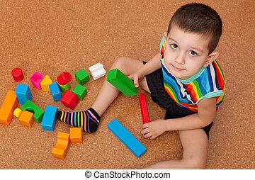 Boy playing vivid toy blocks