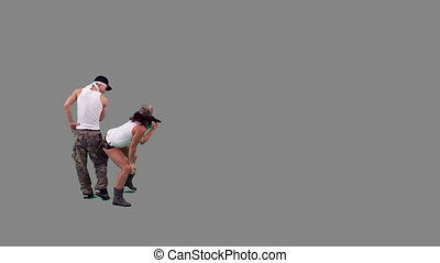 Military Dance Grey Background - A girl and a guy dressed in...