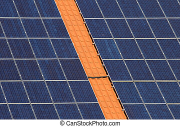 Solar cells on a roof - Many panels with solar cells on a...