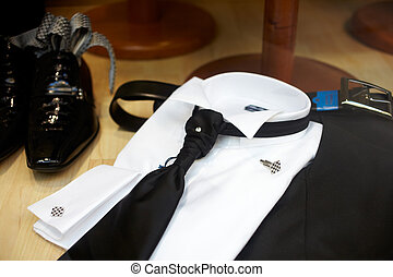 Elegant man clothes - Black Shoes and black necktie on a...