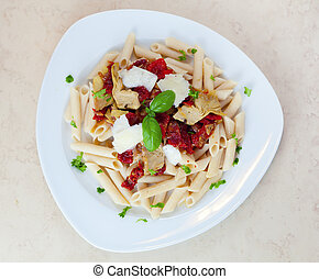 Pasta dish - Top view of a pasta dish with sundried tomatoes...