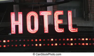 Cheap Hotel. - Hotel sign with flashing lights.