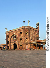 group of worshipers walk on courtyard of Jama Masjid Mosque in Delhi