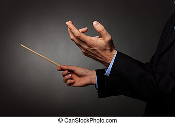 male music conductor directing - Cropped image of a male...