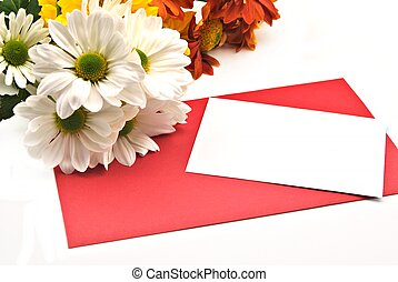 White card on red, next to some daisies