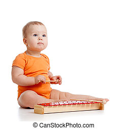 baby playing with musical toy