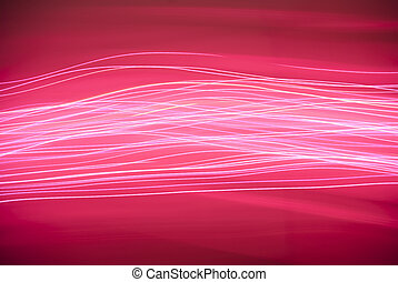 Pink Lines of Light - Lines of pink light streaking across a...