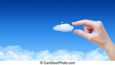 Taking A Cloud Concept - Woman hand taking cloud against...