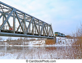 train on bridge through river