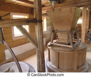 Quern and other equipment for production of flour in old mill.