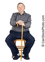 Senior man with cane sitting - Senior or old man sitting...