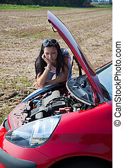 woman has in her car breaks down - young woman in her car...