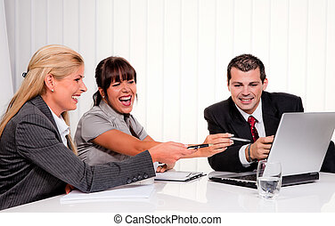successful team in a meeting - successful young team at a...