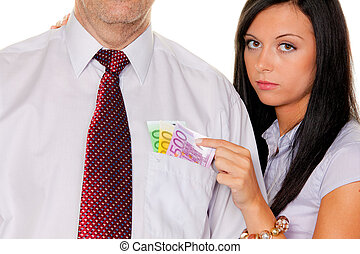woman pulls a man out of his pocket money - young woman...
