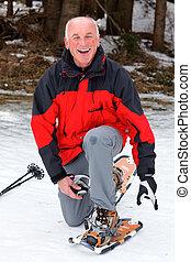 senior when snowshoeing in winter