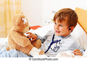 sick child teddy examined - a sick child examined teddy with...