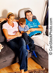 family watching tv with tv - a family watching tv. in the...
