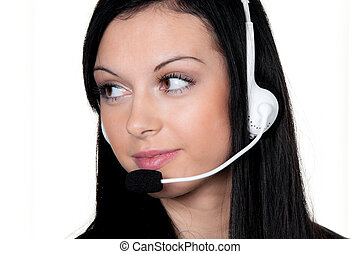 woman with headset in customer service telephone hotline