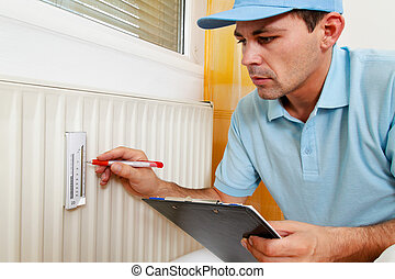 energy savings reading the heating - fitter with radiator...